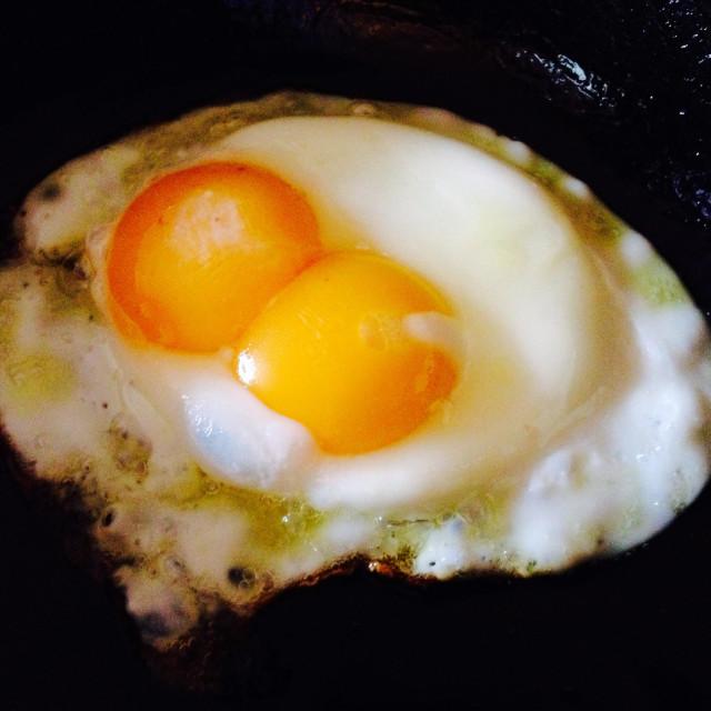 """""""Double yolk egg in frying pan"""" stock image"""