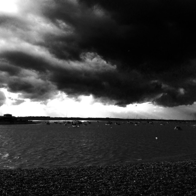 """""""Rain clouds blowing up the river Deben at Felixstowe Ferry, Suffolk, England."""" stock image"""