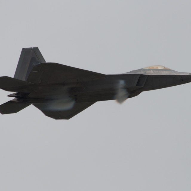 """F-22 Raptor making condensation."" stock image"