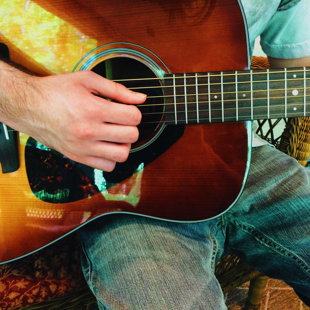 """Man playing acoustic guitar"" stock image"