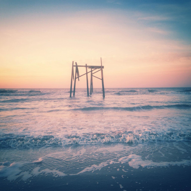 """""""Ruins of an old pier at sunrise"""" stock image"""