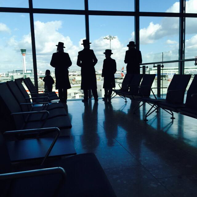 """""""Hasidic Jews preparing to board a plane a few days before Passover. Heathrow terminal five departure lounge"""" stock image"""