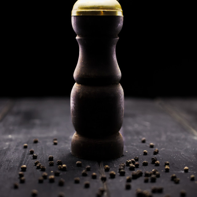 """Old rustic antique pepper and salt grinder on wood boards"" stock image"