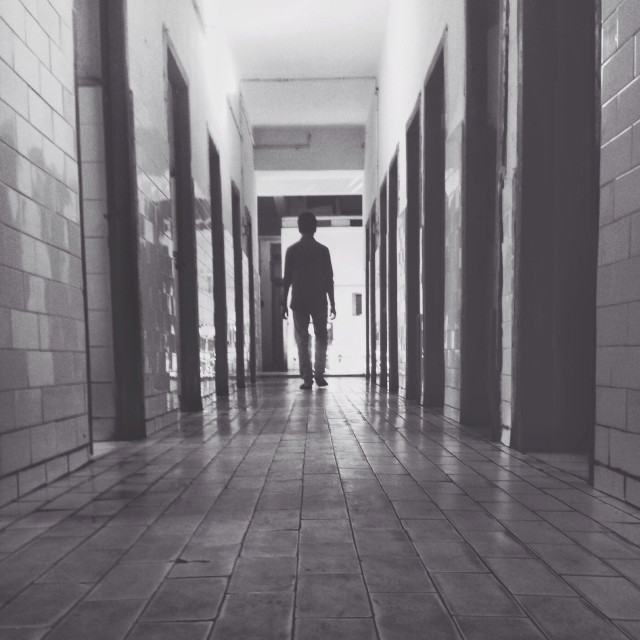 """""""Walking alone into the world of loneliness."""" stock image"""