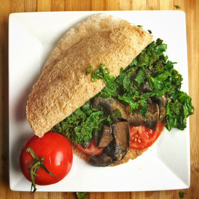 """Vegan pita sandwich with mushrooms and kale"" stock image"