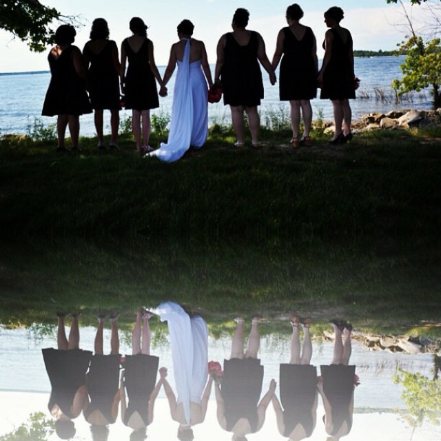 """""""Bride and bridesmaids pause to reflect on friendship and family on this wedding day"""" stock image"""