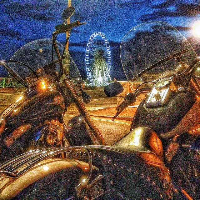 """Two Harley Davidson bikes at night."" stock image"