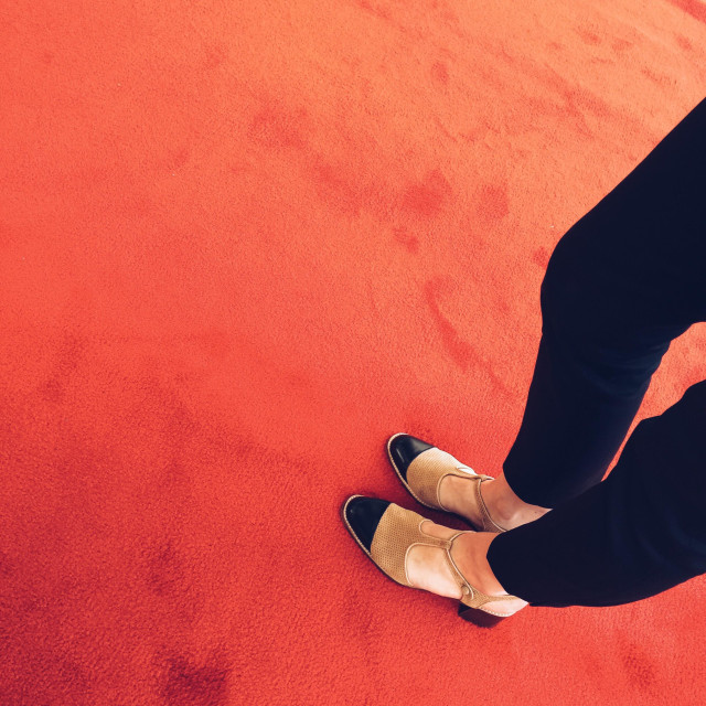 """""""Woman's legs on a red carpet"""" stock image"""