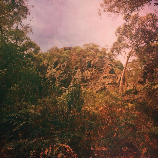 """Hanging rock, Victoria, Australia with textures and light leaks"" stock image"