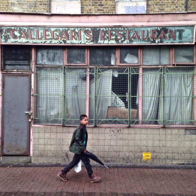 """""""Boy walking in London's East End"""" stock image"""