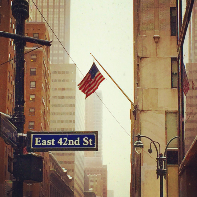 """American flag hanging at East 42nd street"" stock image"