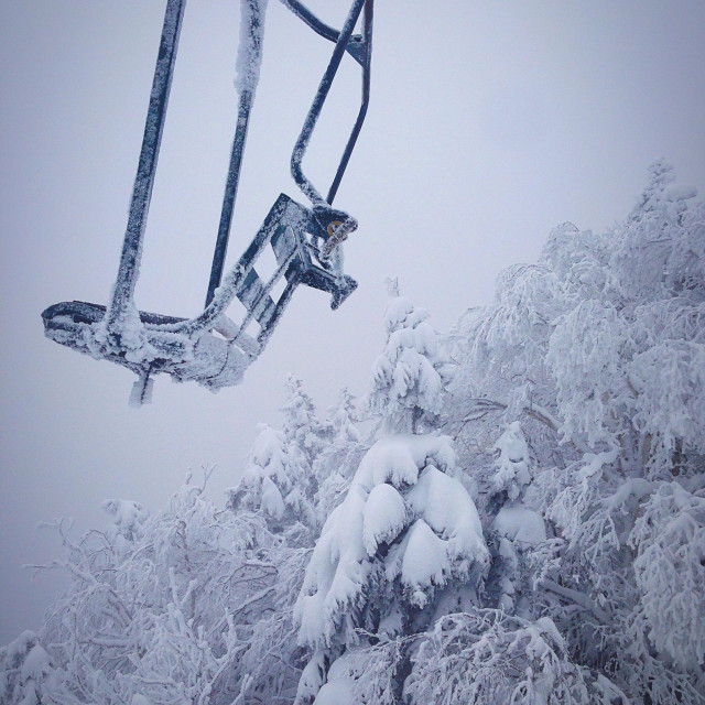 """Frozen trees and chair lift with icicles at Ski Resort in Vermont during winter"" stock image"