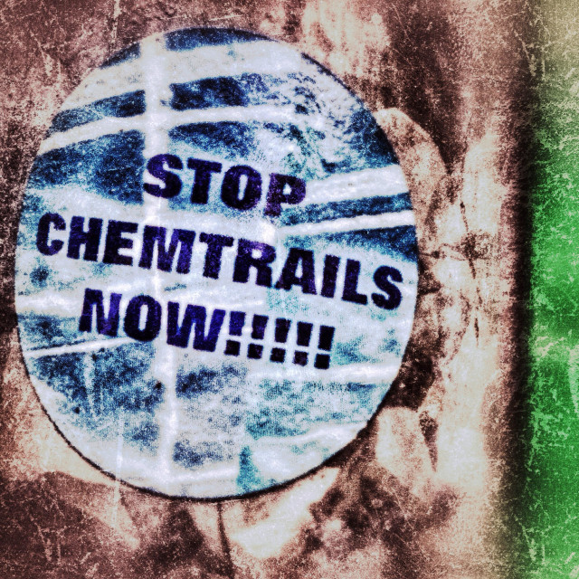 """""""Stop chemtrails Sticker Button on a Lamp Post in Berlin"""" stock image"""