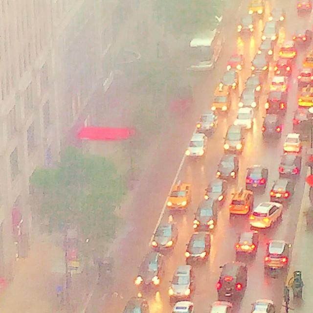 """Gridlocked traffic in rainstorm NYC"" stock image"