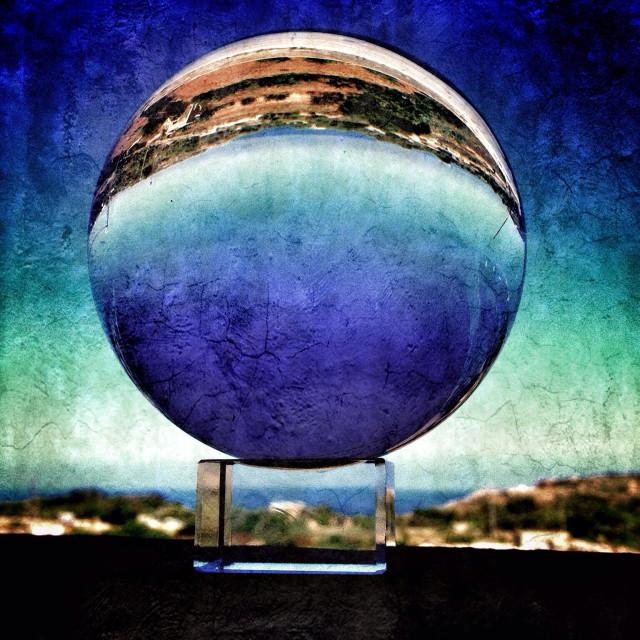 """Land sea and sky viewed through a crystal ball"" stock image"
