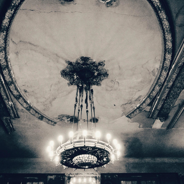"""Faded grandeur - an old ballroom ceiling and light - Clarchens Ballhaus Berlin Germany EU"" stock image"