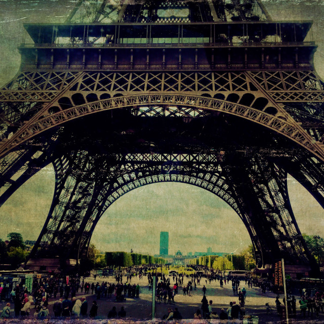 """""""View of Eiffel Tower base, with Montparnasse tower in horizon and tourists below, as seen from tour bus window in Paris, France. Vintage texture overlay."""" stock image"""