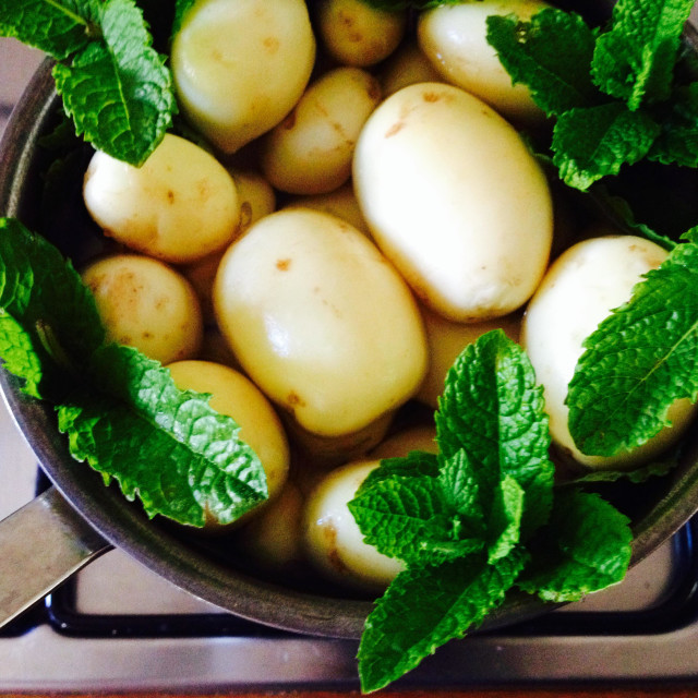 """""""Garden new potatoes in saucepan and mint leaves"""" stock image"""