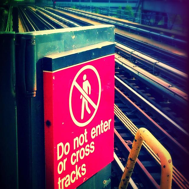 """Warning sign train tracks. NYC"" stock image"