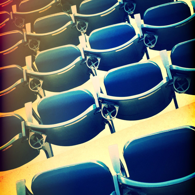 """Bright blue stadium seating"" stock image"