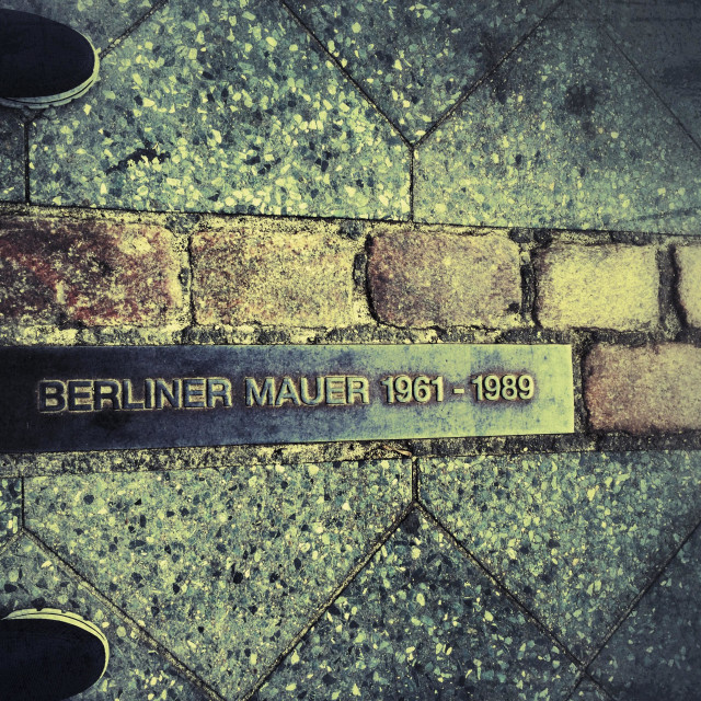 """Man standing at Berlin Wall land mark"" stock image"