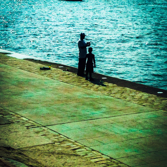 """""""Father and son fishing on the river in Pittsburgh pennsylvania USA. City summer life"""" stock image"""