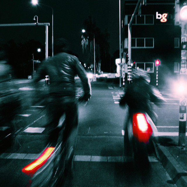 """Hurrying home on the bicycles late at night."" stock image"