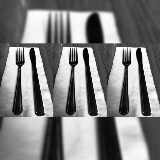 """""""Mirror image of a fork and knife visualizing the concept of hunger"""" stock image"""