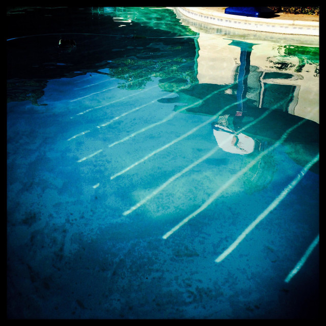 """""""A kids basketball backboard reflected in a swimming pool."""" stock image"""