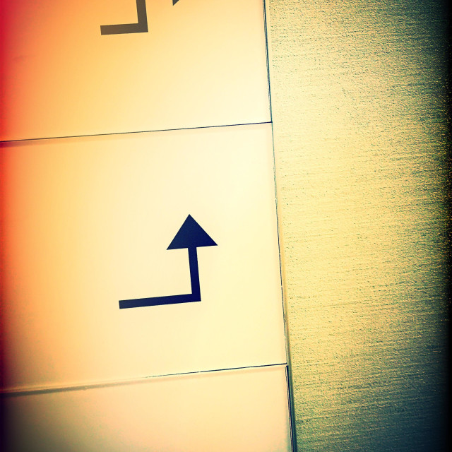 """""""Directional arrows on hall sign"""" stock image"""