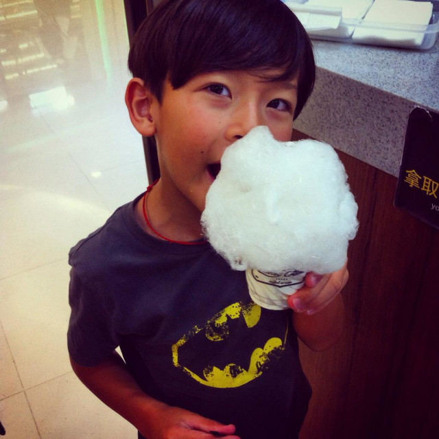 """Boy eating candy floss"" stock image"