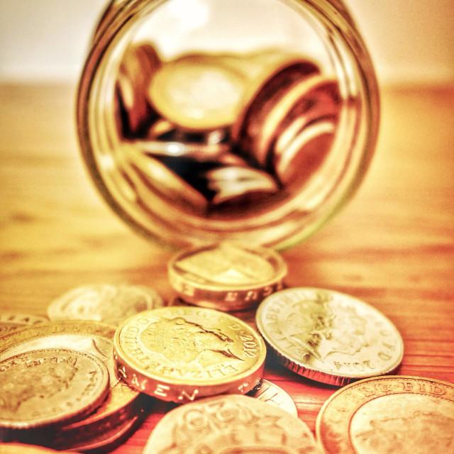 """An emptied savings jar"" stock image"
