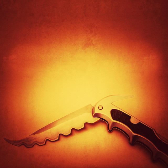 """Savage looking pocket knife"" stock image"