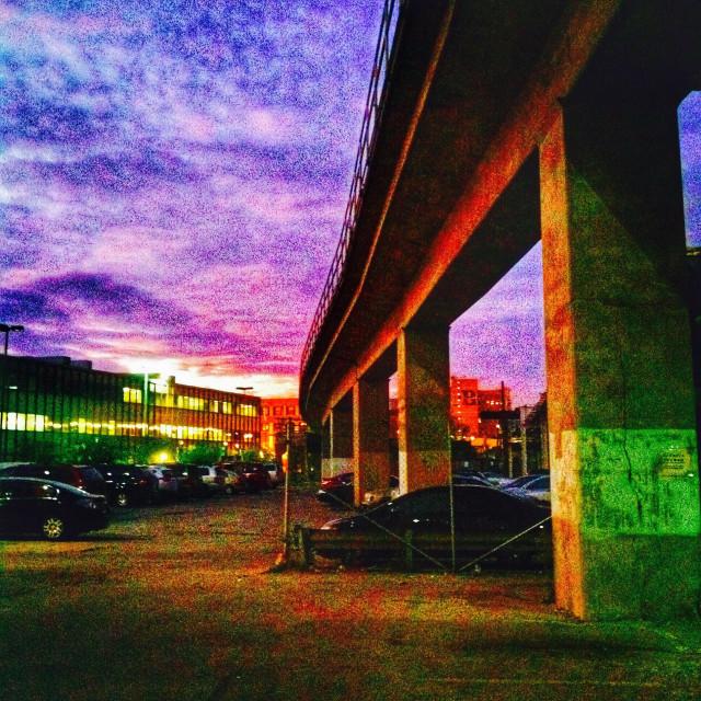 """Walking underneath elevated train tracks at sunset"" stock image"