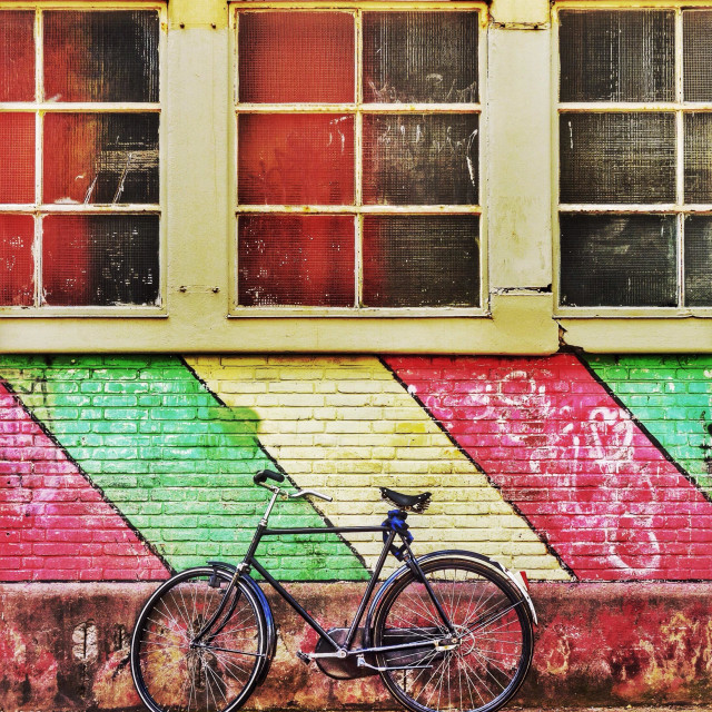 """Painted building and bicycle"" stock image"