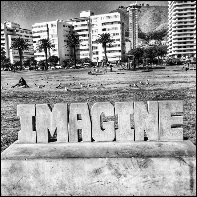 """""""Quaint bench along Seapoint promenade , part of interactive installation art along the walkway. Black and white photo ."""" stock image"""