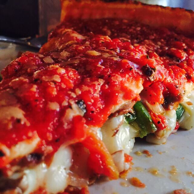 """Chicago Deep Dish pizza! One of the best pizza places in Chicago"" stock image"