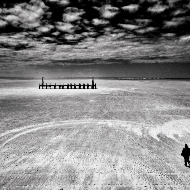 """Solo figure on beach at Lytham St Annes in Lancashire"" stock image"