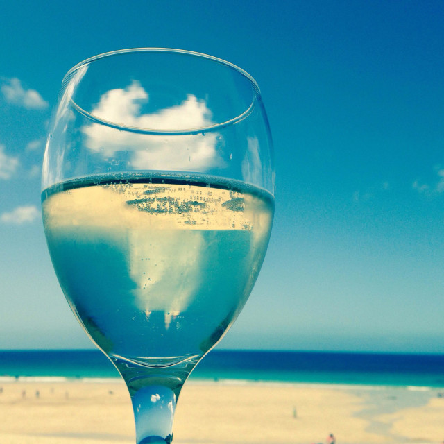"""Prosecco at the beach. Photo taken at Porthmeor Beach, St Ives, Cornwall, U.K."" stock image"