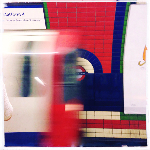 """""""Tube train arriving at Piccadilly Circus"""" stock image"""