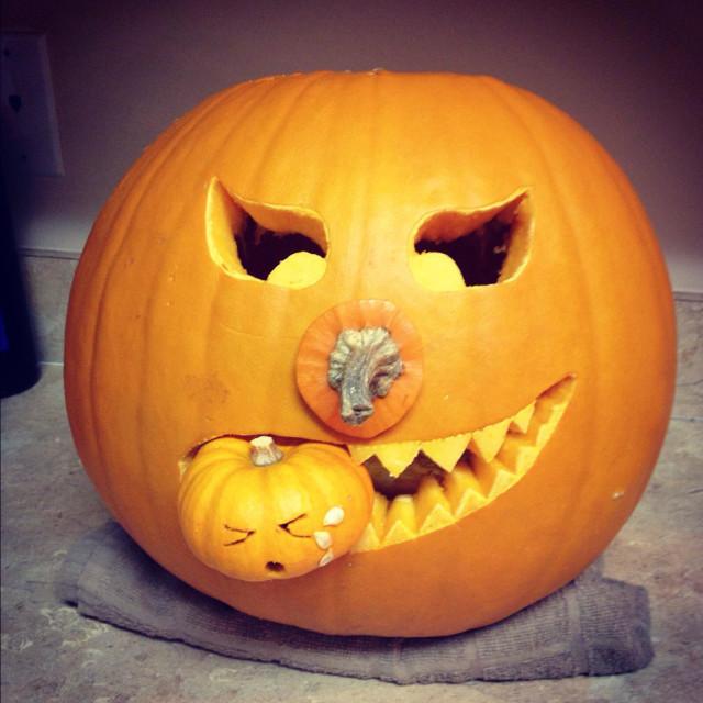 """""""Pumpkin eating a smaller pumpkin"""" stock image"""