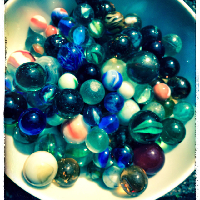 """""""Vintage bowl of marbles"""" stock image"""