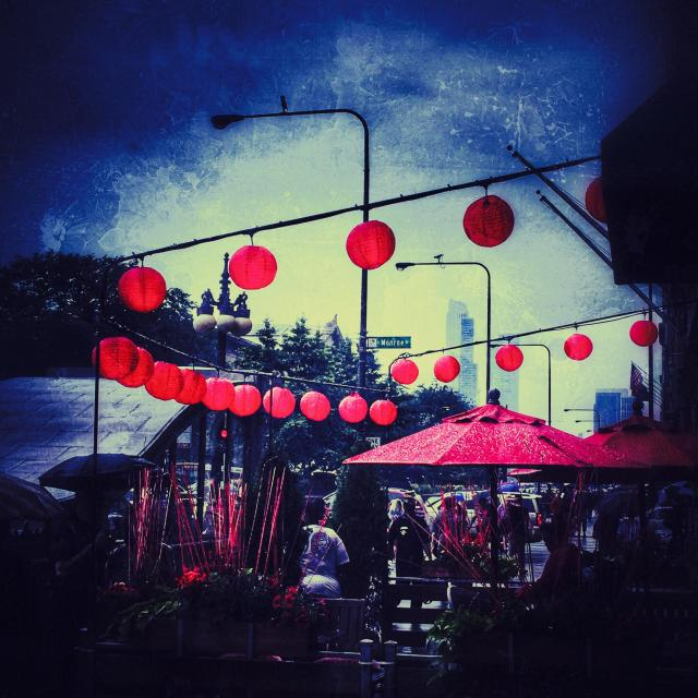 """Red lanterns adorn a restaurant patio"" stock image"