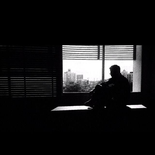 """""""Depressed man by the window."""" stock image"""