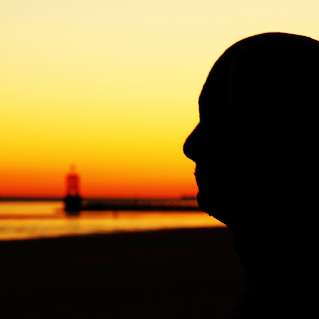 """""""Silhouette of an Iron Man at Crosby beach, Liverpool."""" stock image"""