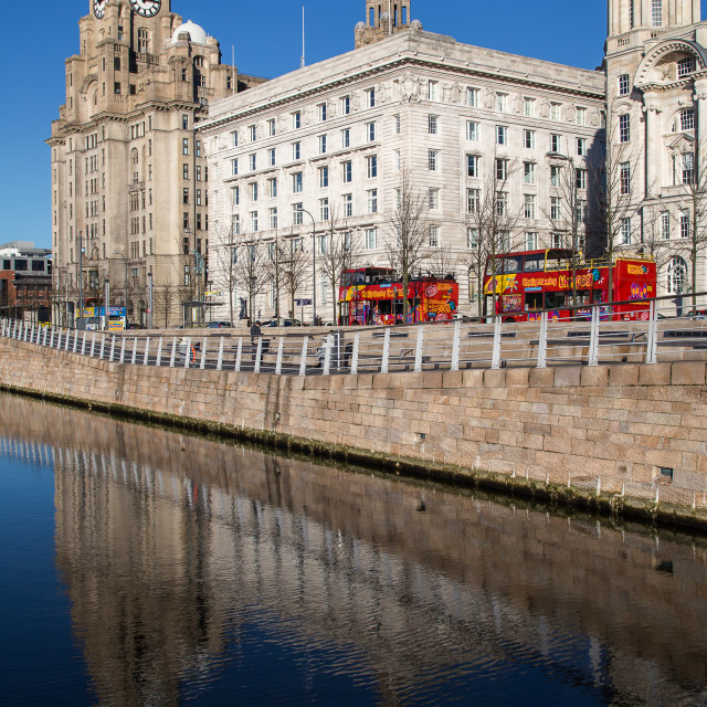 """""""Tour buses parked in front of the Three Graces."""" stock image"""