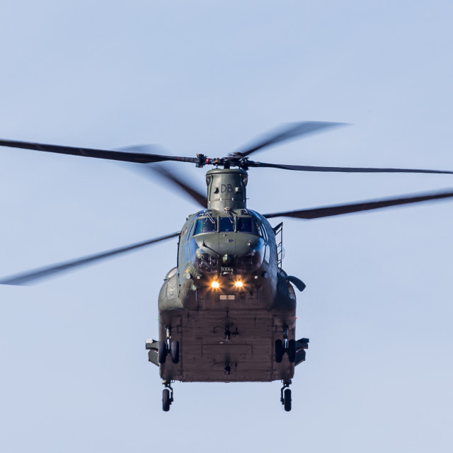 """Face on with the RAF Chinook as it hovers in the sky"" stock image"
