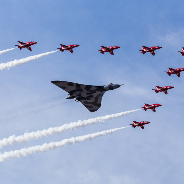 """The Vulcan escorted by the Red Arrows one final time"" stock image"