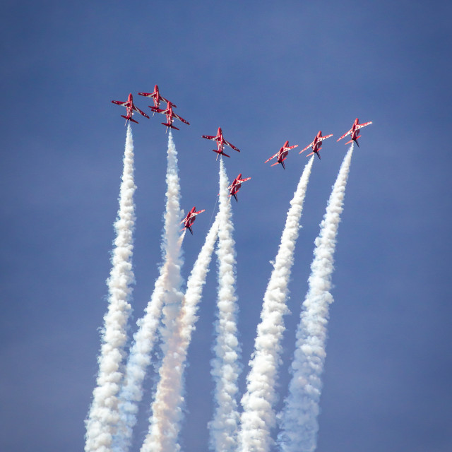 """Red Arrows breaking from the ""Diamond Nine"" formation - at the Southport airshow."" stock image"
