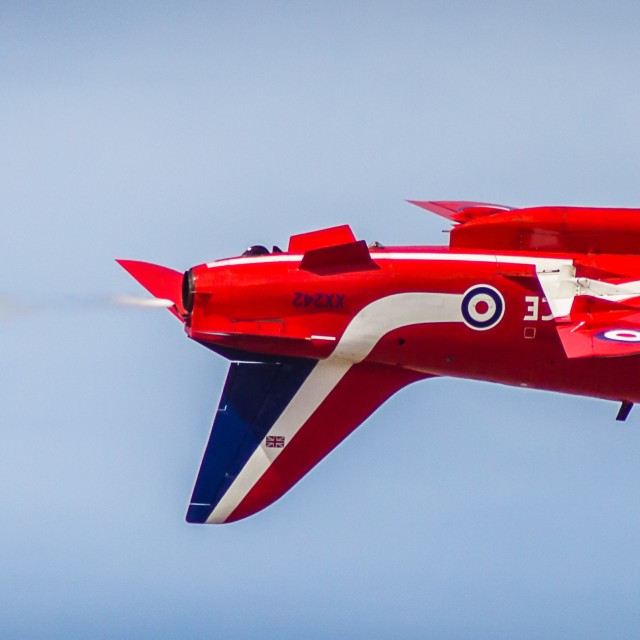 """One of the Red Arrows synchro pair upside town at the Southport airshow."" stock image"